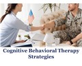 Therapist shaking hands with a military service member with the words cognitive behavioral therapy strategies