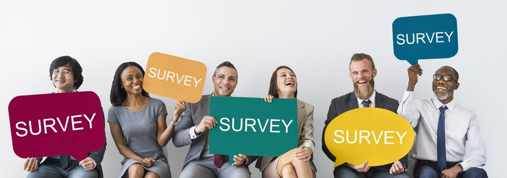 "People holding signs that read ""survey"""