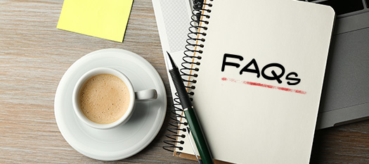 FAQs written on notepad