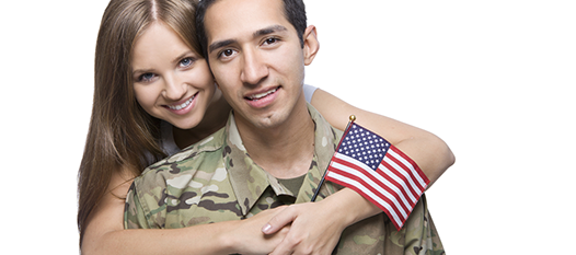 Woman holding american flag hugging servicemember