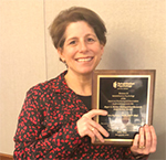 Lisa Brenner being awarded the 2018 Roger G. Barker Distinguished Research Contribution Award